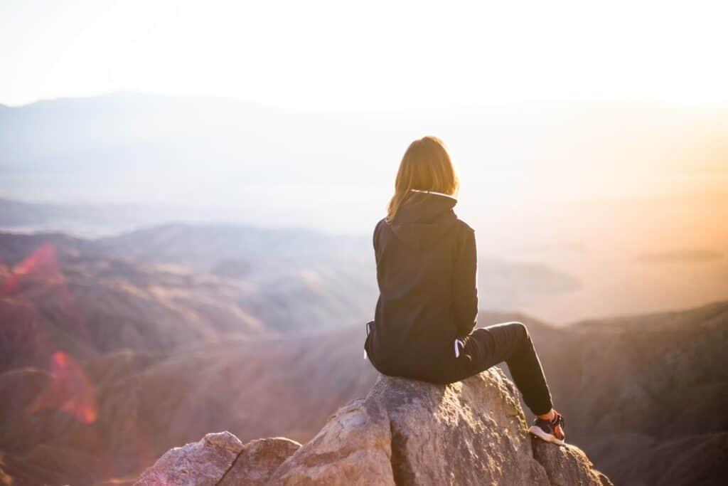 Person Sitting At Their Dream Destination