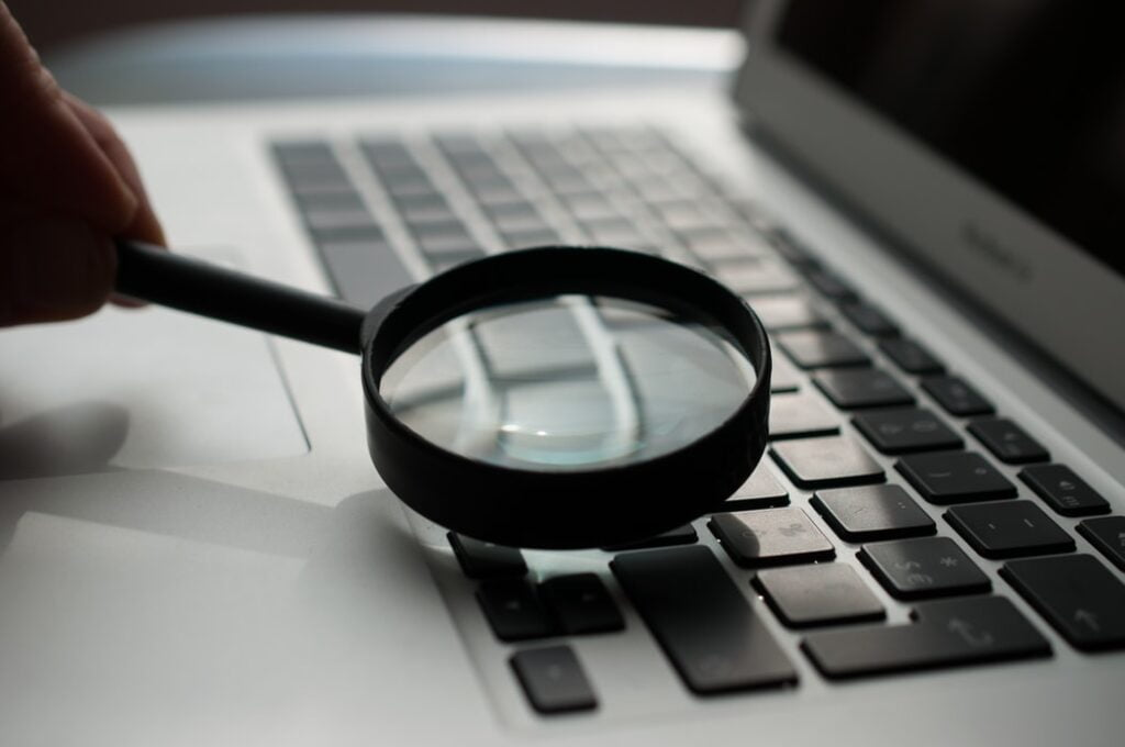 Magnifying Glass Showing Person Looking For A Job