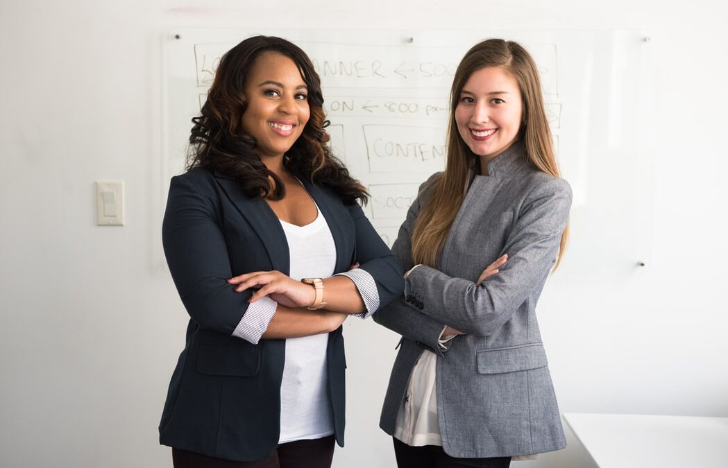 Recruiter And Headhunter Standing Next To Each Other
